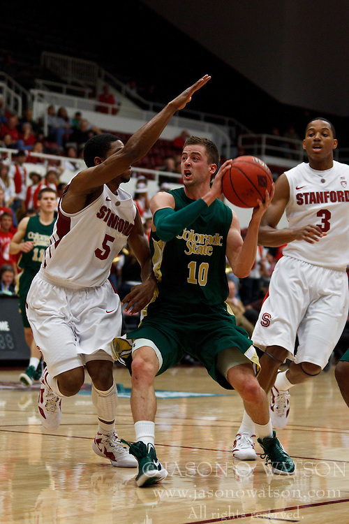Nov 15, 2011; Stanford CA, USA;  Colorado State Rams guard Wes Eikmeier (10) dribbles past Stanford Cardinal guard Chasson Randle (5) during the first half of a preseason NIT game at Maples Pavilion. Mandatory Credit: Jason O. Watson-US PRESSWIRE