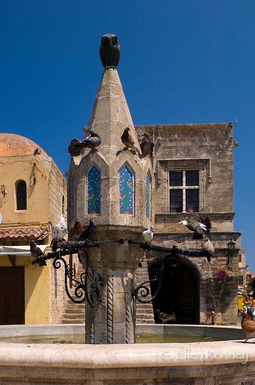 Pigeons on a fountain in Rhodes Town, Rhodes, Dodecanese Islands, Greece
