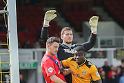 York City forward Reece Thompson and Newport County defender Seth Nana Twumasi grapple at a corner during the Sky Bet League 2 match between Newport County and York City at Rodney Parade, Newport, Wales on 5 September 2015. Photo by Simon Davies.