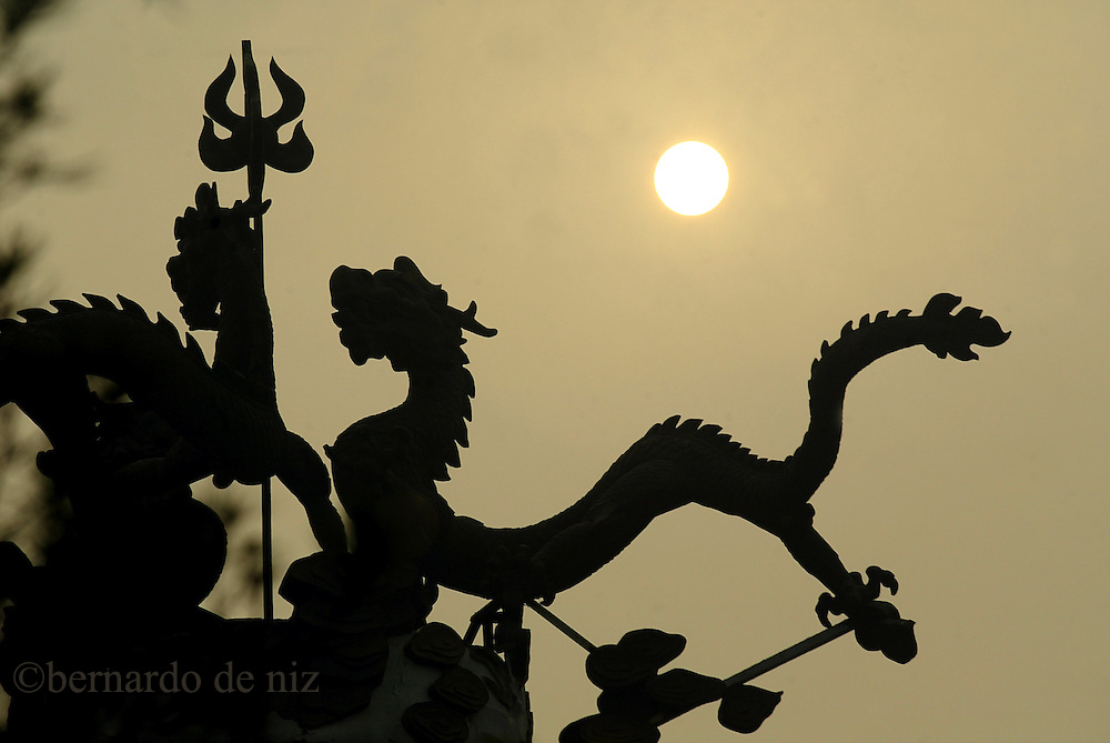 Silhouette  of a dragon in a roof in Beijing, China, August, 2007.