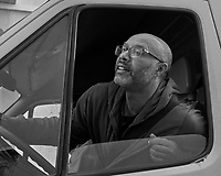 Truck Driver. Morning Street Photography in Lisbon. Image taken with a Leica CL camera and 23 mm f/2 lens.