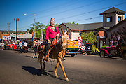 30 JUNE 2012 - PRESCOTT, AZ:   A Shriner rides his mule along the parade route at the Prescott Frontier Days Rodeo Parade. The parade is marking its 125th year. It is one of the largest 4th of July Parades in Arizona. Prescott, about 100 miles north of Phoenix, was the first territorial capital of Arizona.   PHOTO BY JACK KURTZ