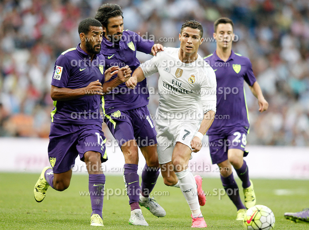 26.09.2015, Estadio Santiago Bernabeu, Madrid, ESP, Primera Division, Real Madrid vs Malaga CF, 6. Runde, im Bild Real Madrid's Cristiano Ronaldo (c-r) and Malaga's Fernando Damian Tissone (l), Marcos Alberto Angeleri (c-l) and Roberto Rosales // during the Spanish Primera Division 6th round match between Real Madrid and Malaga CF at the Estadio Santiago Bernabeu in Madrid, Spain on 2015/09/26. EXPA Pictures &copy; 2015, PhotoCredit: EXPA/ Alterphotos/ Acero<br /> <br /> *****ATTENTION - OUT of ESP, SUI*****