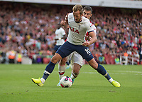 Football - 2019 / 2020 Premier League - Arsenal vs. Tottenham Hotspur<br /> <br /> Harry Kane (Tottenham FC) is adjudged to have dived after feeling the slightest touch from Sokratis Papastathopoulos (Arsenal FC) at The Emirates.<br /> <br /> COLORSPORT/DANIEL BEARHAM