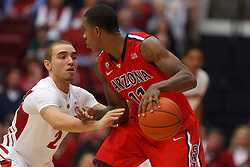 Feb 4, 2012; Stanford CA, USA;  Arizona Wildcats guard Josiah Turner (11) is defended by Stanford Cardinal guard Aaron Bright (2) during the first half at Maples Pavilion.  Mandatory Credit: Jason O. Watson-US PRESSWIRE