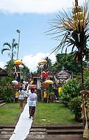 Woman walking to a village festival near Tabanan in Bali, Indonesia