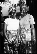 Two Nubian women stand in Ayani Estate before it was built. (1970s)