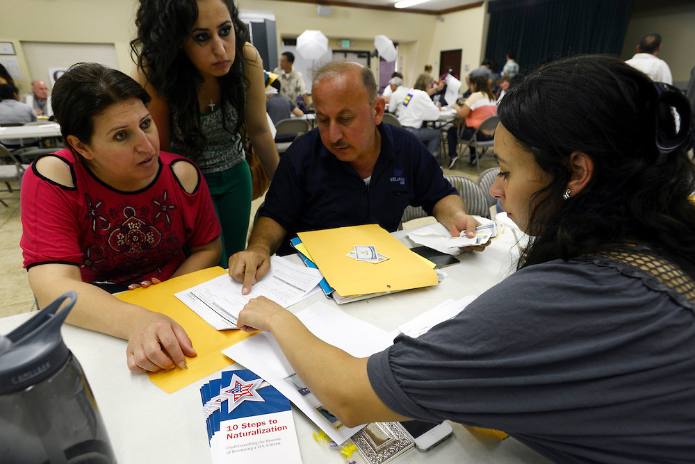 Iraqi families preparing their applications for US citizenship. Although Iraqi refugees face many hardships and challenges when they arrive in the US, most slowly but surely begin to rebuild their lives. After five years, they can apply to become US citizens. El Cajon, CA. USA. 04/05/2013.