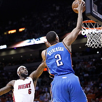 16 March 2011: Oklahoma City Thunder shooting guard Thabo Sefolosha (2) goes for the layup past Miami Heat small forward LeBron James (6) during the Oklahoma City Thunder 96-85 victory over the Miami Heat at the AmericanAirlines Arena, Miami, Florida, USA.