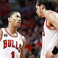10 May 2011: Chicago Bulls point guard Derrick Rose (1) talks to Chicago Bulls center Joakim Noah (13) during the Chicago Bulls 95-83 victory over the Atlanta Hawks, during game 5 of the Eastern Conference semi finals at the United Center, Chicago, Illinois, USA.