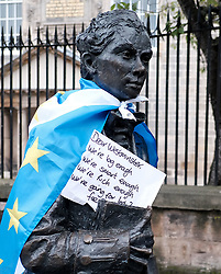 All Under One Banner March, Edinburgh, 5 October 2019<br /> <br /> Pictured: A statue with a flag<br /> <br /> Alex Todd | Edinburgh Elite media