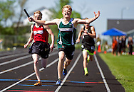 East Grand Forks 1,600-meter relay anchor runner Cole Orthaus crosses the finish line in front of Norman County's Dexter Pelzman during Saturday's Section 8A Track and Field Championship at the Johnson Sports Complex in Ada, Minn. The Green Wave relay team finished with a time of 3 minutes, 33.93 seconds. Nick Wagner / The Forum
