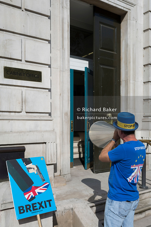 Renowned Brexit protester Steve Bray shouts Remain chants into the doors of the Cabinet Office on Whitehall, the location of daily Brexit contingency planning meetings (codenamed Yellowhammer, in government departments), on 19th August 2019, in London, England.