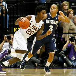 November 16, 2011; Baton Rouge, LA; LSU Tigers guard Destini Hughes (20) drives past Georgetown Hoyas guard Rubylee Wright (3) during the second half of a game at the Pete Maravich Assembly Center. LSU defeated Georgetown 51-40. Mandatory Credit: Derick E. Hingle-US PRESSWIRE