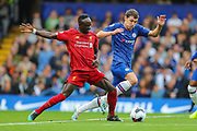 Liverpool forward Sadio Mané (10) is fouled by Chelsea defender Andreas Christensen (4) during the Premier League match between Chelsea and Liverpool at Stamford Bridge, London, England on 22 September 2019.