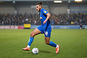 AFC Wimbledon defender Nesta Guinness-Walker (18) dribbling during the EFL Sky Bet League 1 match between AFC Wimbledon and Southend United at the Cherry Red Records Stadium, Kingston, England on 1 January 2020.