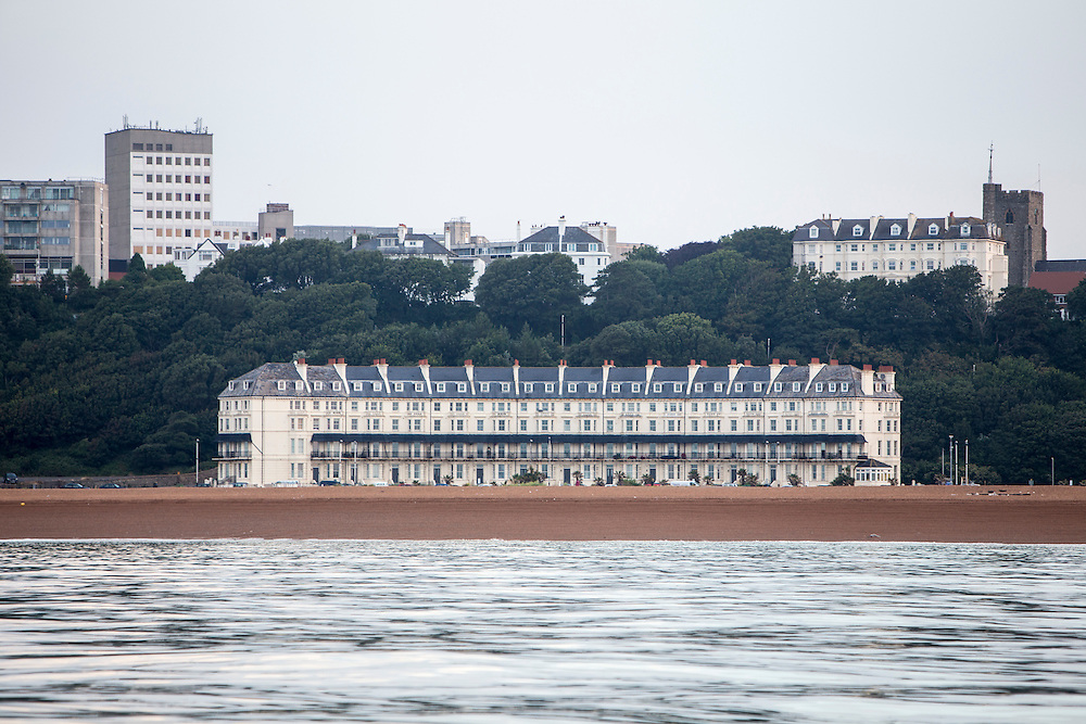 Marine Crescent, a row of 14 beautiful 19th Century Victorian hotels and townhouses with Stucco Architecture which are grade-II listed buildings along Folkestone seafront, Kent, England, United Kingdom.  This was a elegant and fashionable destination for Victorian and Edwardian holidaymakers.  (photo by Andrew Aitchison / In pictures via Getty Images)