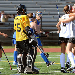Strath Haven's Mizuki Davis (2) and Megan Murray (19) celebrate a goal as Springfield goalie Ally Scanlon (25) looks on during the Springfield at Strath Haven girls field hockey game in Nether Providence on Thursday, September 4, 2014.  (Times staff / TOM KELLY IV)