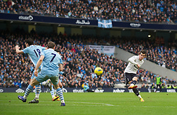 MANCHESTER, ENGLAND - Sunday, January 22, 2011: Tottenham Hotspur's Gareth Bale scores his side's first goal against Manchester City during the Premiership match at the City of Manchester Stadium. (Pic by David Rawcliffe/Propaganda)