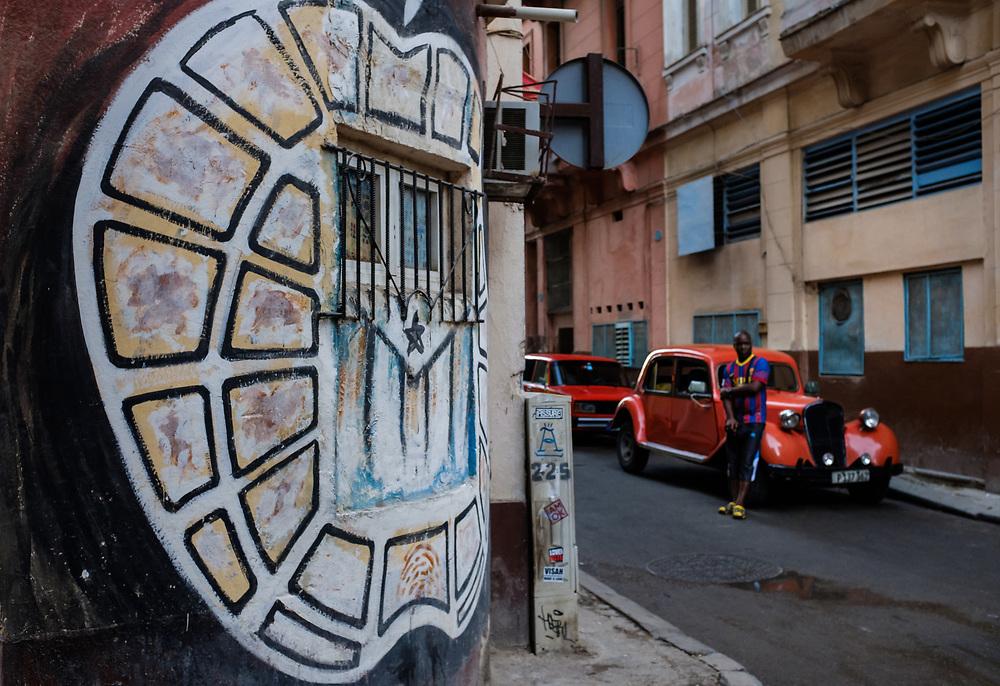 HAVANA, CUBA - CIRCA MARCH 2017: Graffiti art and old classic car in Havana.