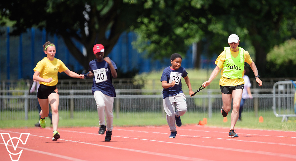 Metro Blind Sport's 2017 Athletics Open held at Mile End Stadium.  100m.  Ebenezer Adu-Poku with guide runner, left, and Clinton Njoku with guide runner<br /> <br /> Picture: Chris Vaughan Photography for Metro Blind Sport<br /> Date: June 17, 2017