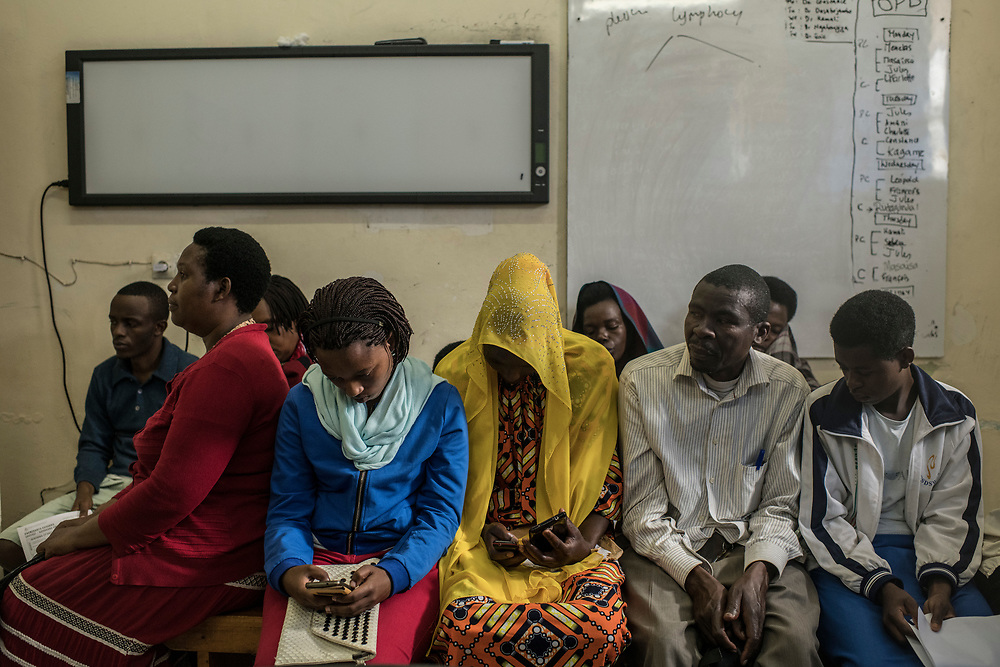 People sit in a waiting room during a screening for Rheumatic heart disease at the University Teaching Hospital of Kigali in Rwanda.<br /> <br /> Rheumatic heart disease is damage to one or more heart valves that stems from inadequately treated strep throat. Left untreated, rheumatic heart disease leads to heart failure.