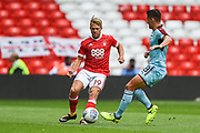 Burnley midfielder Ashley Westwood (18) tackles Nottingham Forest midfielder Ben Osborn (11) resulting in an injury and leaving the pitch during the Pre-Season Friendly match between Nottingham Forest and Burnley at the City Ground, Nottingham, England on 29 July 2017. Photo by Jon Hobley.