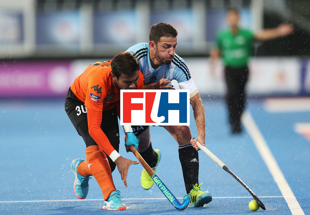 LONDON, ENGLAND - JUNE 16:  Manuel Brunet of Argentina and Izad Jamaluddin of Malaysia battle for the ball during the Pool A match between Argentina and Malaysia on day two of Hero Hockey at Lee Valley Hockey and Tennis Centre on June 16, 2017 in London, England.  (Photo by Alex Morton/Getty Images)