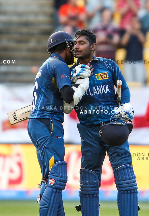 Lahiru Thirimanne  congratulates Kumar Sangakkara after Sangakkara reaches his century during the 2015 ICC Cricket World Cup Pool A group match between England Vs Sri Lanka at the Wellington Regional Stadium, Wellington, New Zealand.