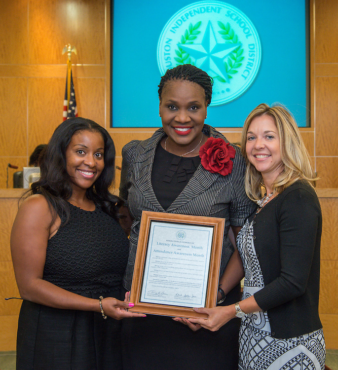 Houston ISD trustee Wanda Adams, center, recognizes Julie Baker Finck, right, and Tiffaney Hunter, right, of the Barbara Bush Houston Literacy Foundation during a Board of Trustees meeting, September 10, 2015.