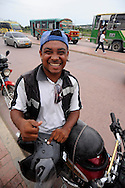 A motor cycle taxi driver waits for a customer outside the walled city of Cartagena