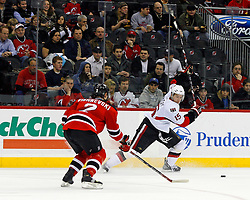 February 13, 2008; Newark, NJ, USA;  New Jersey Devils defenseman Vitaly Vishnevski (2) defends against a slap shot by Ottawa Senators left wing Dany Heatley (15) during the first period at the Prudential Center in Newark, NJ.