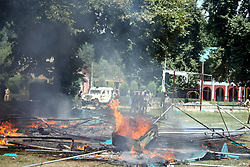 August 31, 2017 - Anantang, Jammu And Kashmir, India - Massive clashes erupted at Boys Degree College Khanabal in south Kashmir's Anantnag district after police hoist Indian tricolour flag during sports event in college campus.An eye witness said that the protesting students set ablaze a tent and also pelted police with stones.Police also fired several teargas canisters to disperse the protesting students (Credit Image: © Aasif Shafi/Pacific Press via ZUMA Wire)