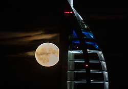 © Licensed to London News Pictures. 24/10/2018. Portsmouth, UK. A full Hunter's moon rises behind The spinnaker Tower in Portsmouth, Hampshire. October's full moon is called the 'Hunter's Moon' as traditionally at this time of year people would go out by moonlight to hunt for food for the winter months ahead. Photo credit: Peter Macdiarmid/LNP