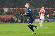 Muted Goal celebration by Leeds United midfielder Ezgjan Alioski (10)  during the EFL Sky Bet Championship match between Stoke City and Leeds United at the Bet365 Stadium, Stoke-on-Trent, England on 19 January 2019.
