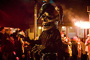 A member of the Skeleton Krewe as they lead Le Krewe d'Etat from Magazine Street to Napoleon Avenue at Mardi Gras in New Orleans, Louisiana, USA.