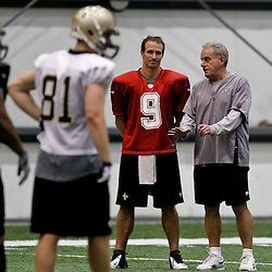 July 26, 2012; Metairie, LA, USA; New Orleans Saints quarterback Drew Brees (9) talks with assistant head coach and linebackers coach Joe Vitt during the first day of of training camp at the team's indoor practice facility. Mandatory Credit: Derick E. Hingle-US PRESSWIRE