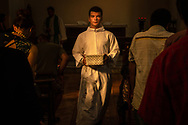 Sergiu Trifa, son of the Rev. Sorin Horia Trifa, pastor of the Confessional Lutheran Church of Romania, collects the offertory on Sunday, July 22, 2018, during worship in Bucharest. LCMS Communications/Erik M. Lunsford