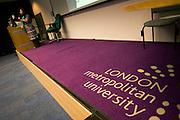 Purple corporate logo on lecture threatre carpet of London Metropolitan University's Holloway Road.