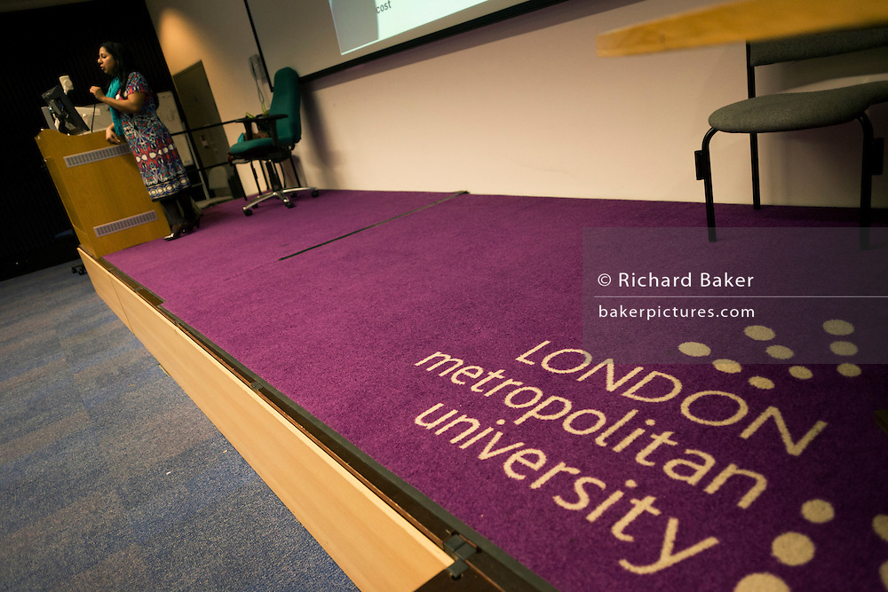 Purple corporate logo on lecture threatre carpet of London Metropolitan University's Holloway Road.