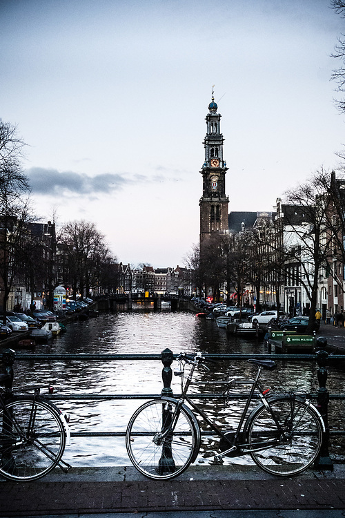 A classic view of Amsterdam's west church with its distinctive crown on its steeple.