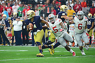 GLENDALE, AZ - JANUARY 01:  Quarterback DeShone Kizer #14 of the Notre Dame Fighting Irish slips past linebacker Raekwon McMillan #5 of the Ohio State Buckeyes during the first quarter of the BattleFrog Fiesta Bowl at University of Phoenix Stadium on January 1, 2016 in Glendale, Arizona.  (Photo by Jennifer Stewart/Getty Images)