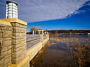 29 MARCH 2019 - ST. PAUL, MN: A flood wall holds back the Mississippi River at the St. Paul Downtown Airport. One runway at the airport is closed because of the potential for flooding and the height of the flood wall. The Mississippi River through the Twin Cities has already hit flood stage. Several roads and parks in St Paul are already closed in anticipation of higher flood levels. Weather forecasters and hydrologists have backed off a little on earlier predictions of severe flooding because the snow melt has been slower than expected.     PHOTO BY JACK KURTZ