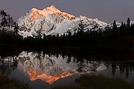 Alpenglow on Mount Shuksan reflected in Picture Lake at the Mount Baker-Snoqualmie National Forest, Washington State, USA