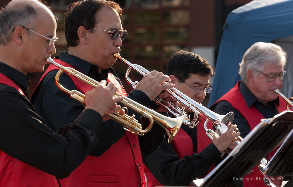 Members of the Minidoka Swing Band perform at the Bill Naito Legacy Fountain at Waterfront Park, Portland, Oregon. The July 2010 performance was part of the festivities around the rededication of the Japanese American Historical Plaza.