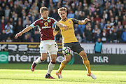 Arsenal defender Nacho Monreal (18) and Burnley midfielder Johann Berg Guomundsson (25)  battle during the Premier League match between Burnley and Arsenal at Turf Moor, Burnley, England on 2 October 2016. Photo by Pete Burns.