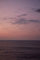 Pastel colored sky and clouds over the Pacific Ocean at dawn.  Image 15 of 21  for a panorama taken with a Fuji X-T1 camera and 35 mm f/1.4 lens  (ISO 400, 35 mm, f/2.8, 1/30 sec). Raw images processed with Capture One Pro and stitched together with AutoPano Giga Pro.