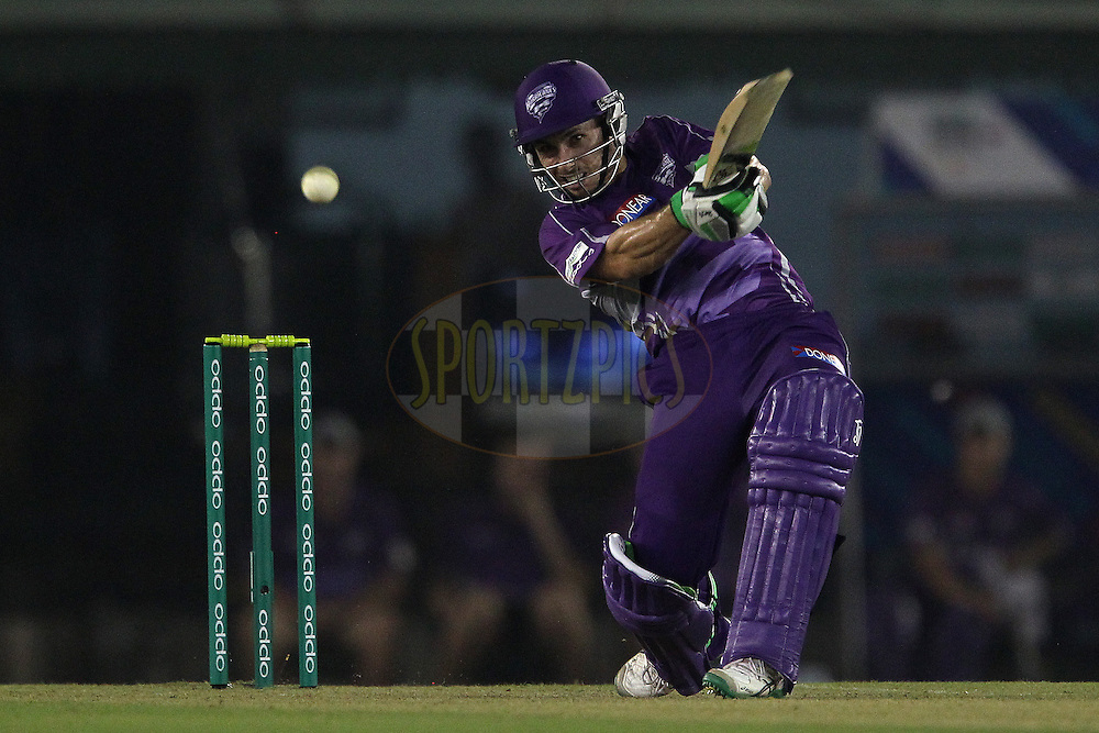Jon WELLS of the Hobart Hurricanes hits over the top for four during match 2 of the Oppo Champions League Twenty20 between the Kings XI Punjab and the Hobart Hurricanes held at the Punjab Cricket Association Stadium, Mohali, India on the 18th September 2014<br /> <br /> Photo by:  Ron Gaunt / Sportzpics/ CLT20<br /> <br /> <br /> Image use is subject to the terms and conditions as laid out by the BCCI/ CLT20.  The terms and conditions can be downloaded here:<br /> <br /> http://sportzpics.photoshelter.com/gallery/CLT20-Image-Terms-and-Conditions-2014/G0000IfNJn535VPU/C0000QhhKadWcjYs