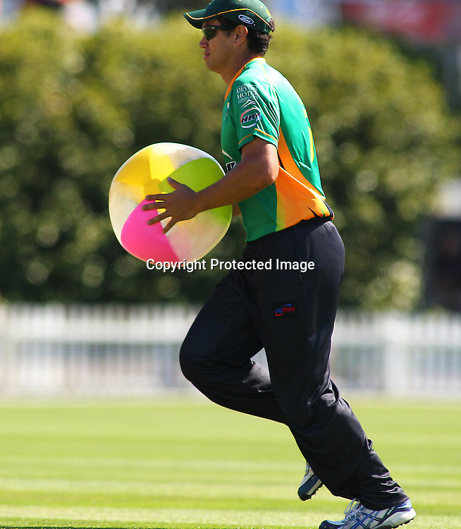 Ross Taylor removes a beach ball from the pitch during their Twenty20 Cricket match - HRV Cup, Wellington Firebirds v Central Stags, 27 December 2011, Hawkins Basin Reserve, Wellington. . PHOTO: Grant Down / photosport.co.nz