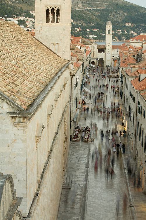Europe, Croatia, Dalmatia, Dubrovnik.  Pedestrians fill the Stradun (also known as Placa), the main street which crosses the old city, elevated view with blurred motion. The historic center of Dubrovnik is a UNESCO World Heritage site.